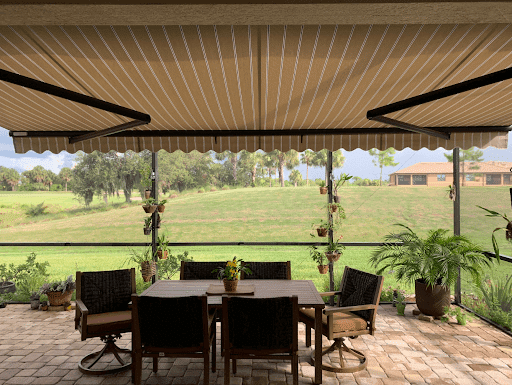 yellow striped retractable awning fabric in tampa florida | sun protection