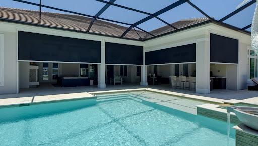retractable black roll screens by pool sarasota florida | sun protection
