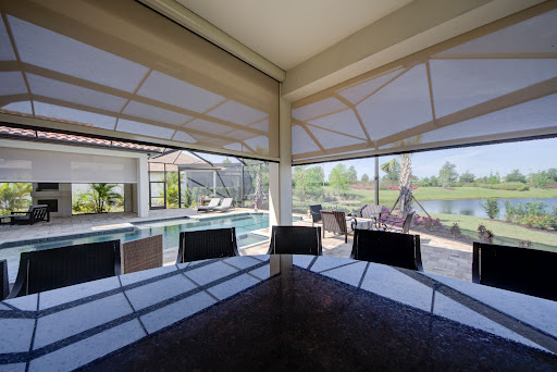 retractable screen by pool bar sarasota florida | sun protection