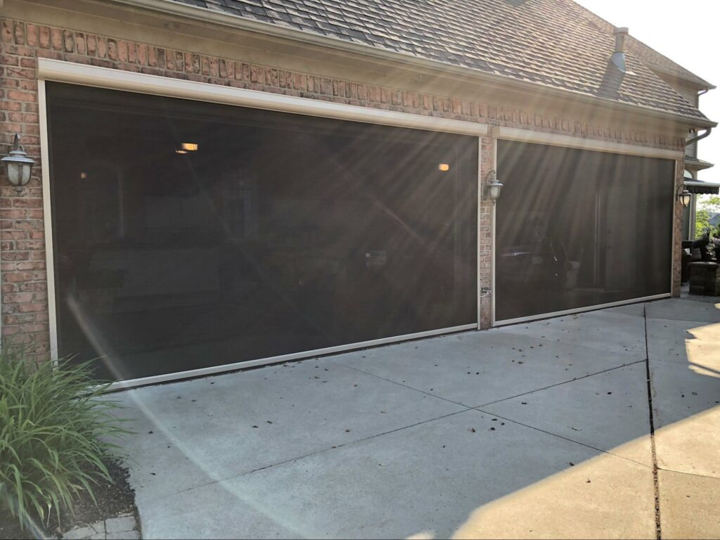 garage with a retractable mosquito screen to keep the insects out, tampa, florida motorized roll down shade | sun protection