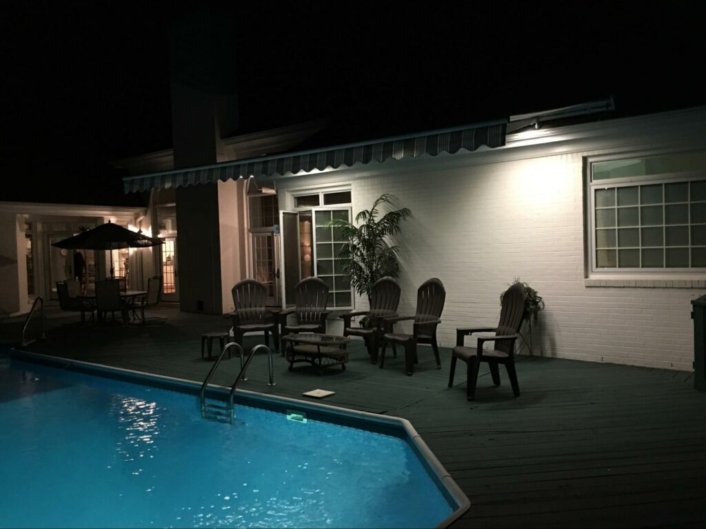 poolside retractable sun awning with led lights miami, florida motorized lanai  roof   sun protection
