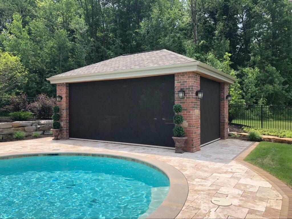 poolside lanai with motorized retractable sun screen,tampa, florida retractable patio screen | sun protection