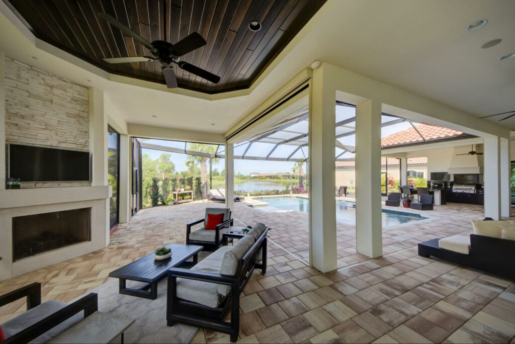 a retractable roll screen sarasota by the pool from sun protection of florida